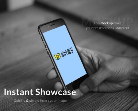 黑白色单手操作的苹果iphone手机显示内容样机设计素材