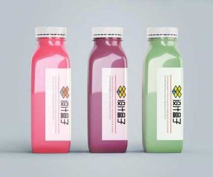 三种不同颜色的果汁饮料瓶上的包装设计样机PSD图片模板