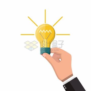 一只手拿着一个发光的黄色电灯泡象征了创意点子png图片素材